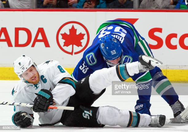 Bo Horvat of the Vancouver Canucks checks over Joe Pavelski of the San Jose Sharks during their NHL game at Rogers Arena February 2 2017 in Vancouver...