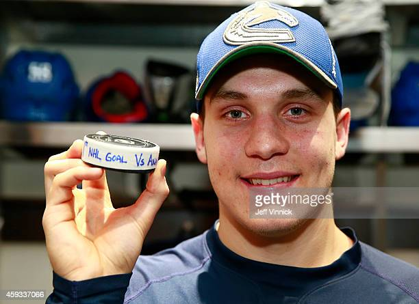 Bo Horvat of the Vancouver Canucks displays the puck for his first NHL goal scored against the Anaheim Ducks during their NHL game at Rogers Arena...