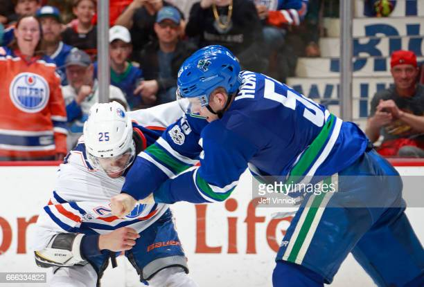 Bo Horvat of the Vancouver Canucks fights Darnell Nurse of the Edmonton Oilers during their NHL game at Rogers Arena April 8 2017 in Vancouver...