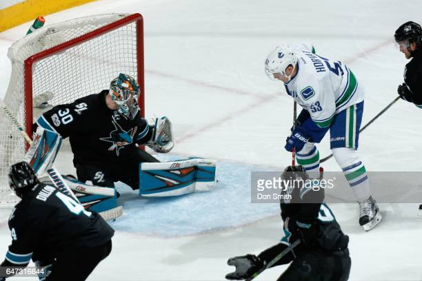 Bo Horvat of the Vancouver Canucks gets one by Aaron Dell of the San Jose Sharks to score a goal in the first period at SAP Center at San Jose on...