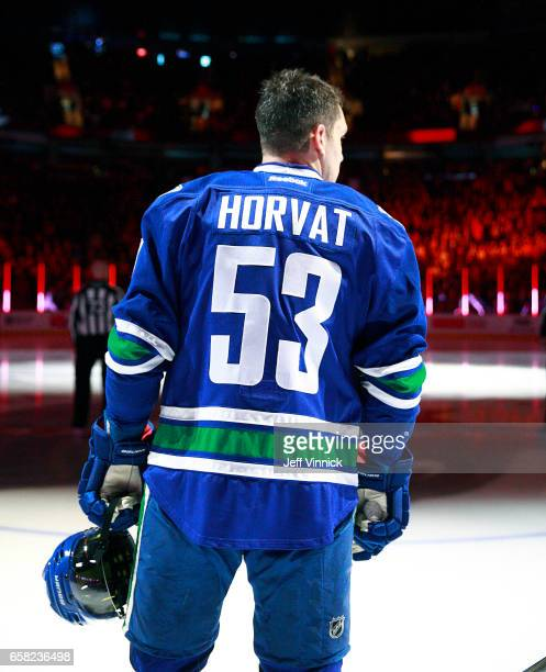Bo Horvat of the Vancouver Canucks listens to the national anthem during their NHL game against the Dallas Stars at Rogers Arena March 16 2017 in...