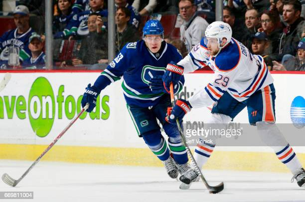 Bo Horvat of the Vancouver Canucks looks on a Leon Draisaitl of the Edmonton Oilers passes the puck up ice during their NHL game at Rogers Arena...