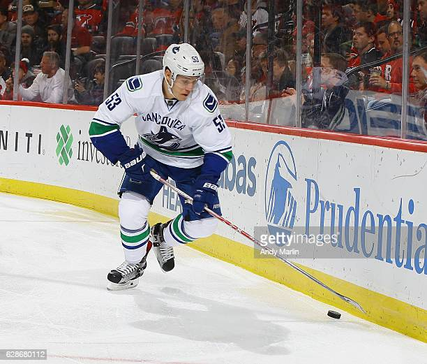 Bo Horvat of the Vancouver Canucks plays the puck against the New Jersey Devils during the game at Prudential Center on December 6 2016 in Newark New...
