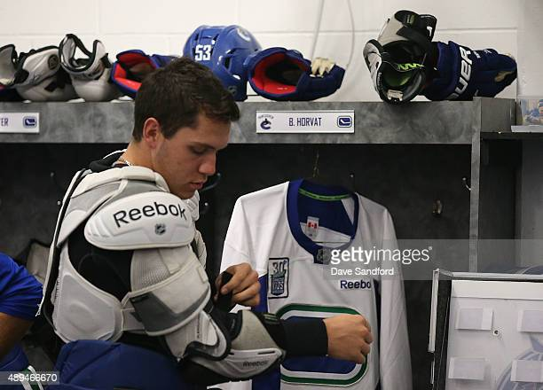 Bo Horvat of the Vancouver Canucks puts on an elbow pad for practice during Day 3 of NHL Kraft Hockeyville at the Q Centre on September 21 2015 in...