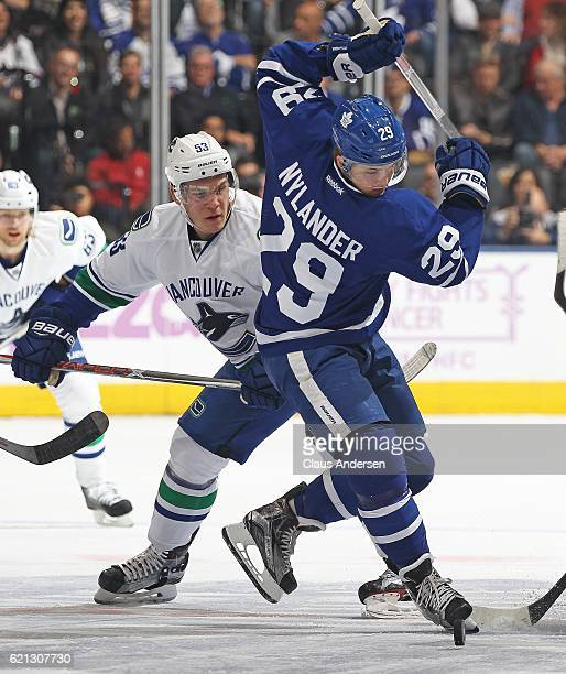 Bo Horvat of the Vancouver Canucks skates against William Nylander of the Toronto Maple Leafs during an NHL game at the Air Canada Centre on November...