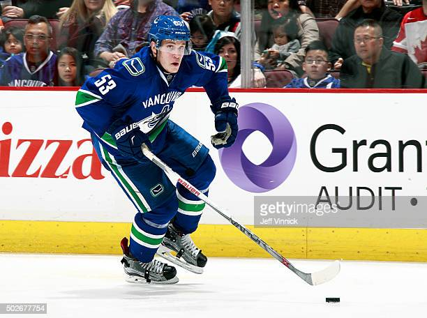 Bo Horvat of the Vancouver Canucks skates up ice with the puck during their NHL game against the Edmonton Oilers at Rogers Arena December 26 2015 in...
