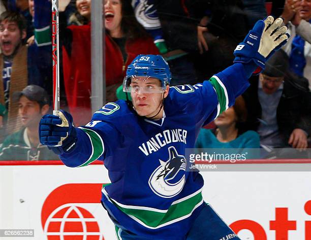 Bo Horvat of the Vancouver Canucks turns to celebrate a goal by Sven Baertschi against the Minnesota Wild during their NHL game at Rogers Arena...