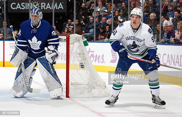 Bo Horvat of the Vancouver Canucks waits for the puck beside Frederik Andersen of the Toronto Maple Leafs during the first period at the Air Canada...