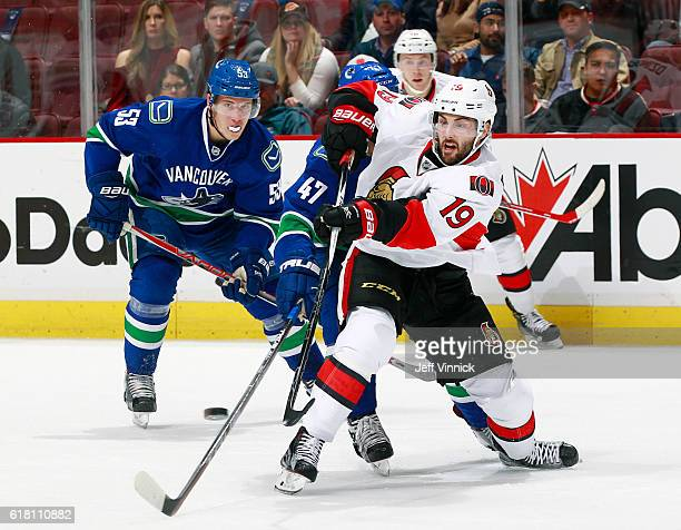 Bo Horvat of the Vancouver Canucks watches Derick Brassard of the Ottawa Senators play the puck during their NHL game at Rogers Arena October 25 2016...