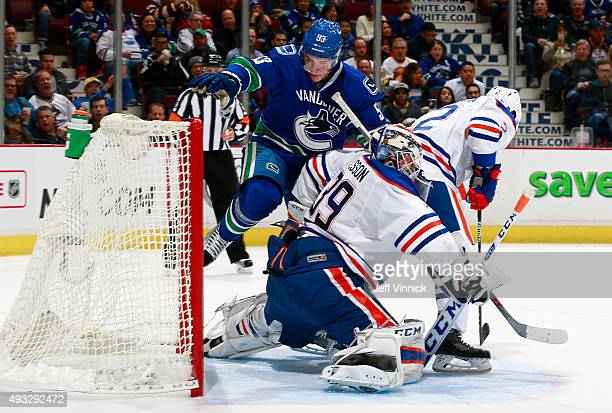 Bo Horvat of the Vancouver Canucks watches the puck enter the net behind Anders Nilsson of the Edmonton Oilers for a goal by Matt Bartkowski of the...