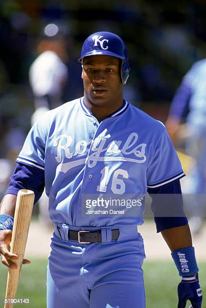 Bo Jackson of the Kansas City Royals walks on the field with his bat on hand during a game in the 1990 season