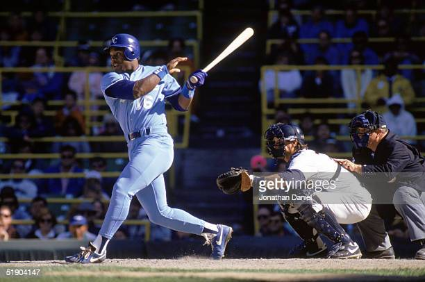 Bo Jackson of the Kansas City Royals watches the flight of the ball as he follows through on his swing during a game in the 1990 season