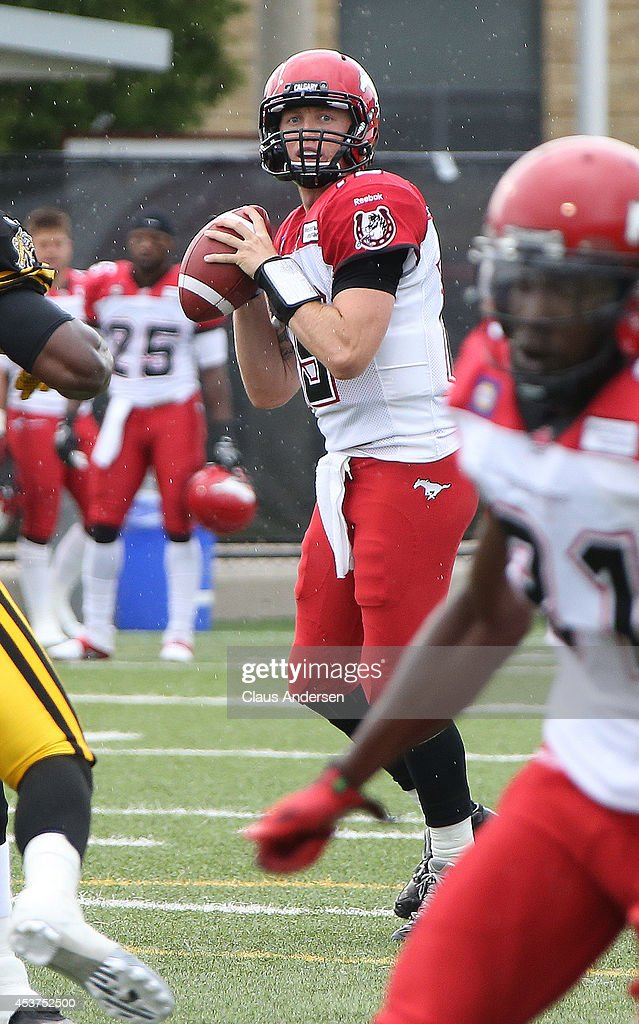 Bo Levi Mitchell of the Calgary Stampeders looks for a receiver against the Hamilton TigerCats in a CFL game at Ron Joyce Stadium on August 16 2014...