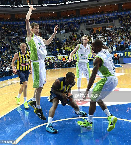 Bo McCalebb #4 of Fenerbahce Ulker Istanbul competes with Fran Vazquez #17 of Unicaja Malaga and Earl Calloway #11 of Unicaja Malaga in action during...