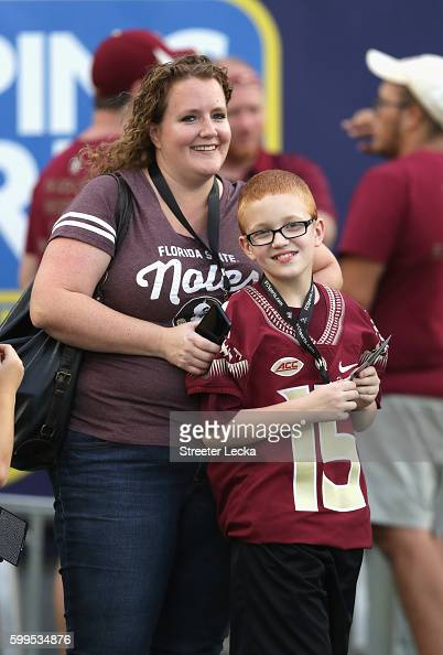 Bo Paske and mother Leah Paske are seen on the sideline prior to the Camping World Kickoff between the Florida State Seminoles and the Mississippi...