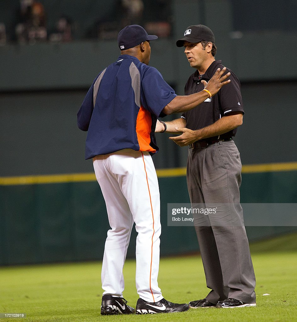 Bo Porter #16 of the Houston Astros argues with first base umpire James Hoye after Brandon Barnes #2 of the Houston Astros was called out on a close play in the fifth inning at Minute Maid Park on July 1, 2013 in Houston, Tx.)