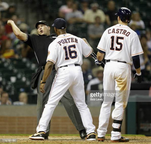 Bo Porter of the Houston Astros is thrown out of the game by home plate umpire Mark Carlson for arguing a strike called on Jason Castro of the...