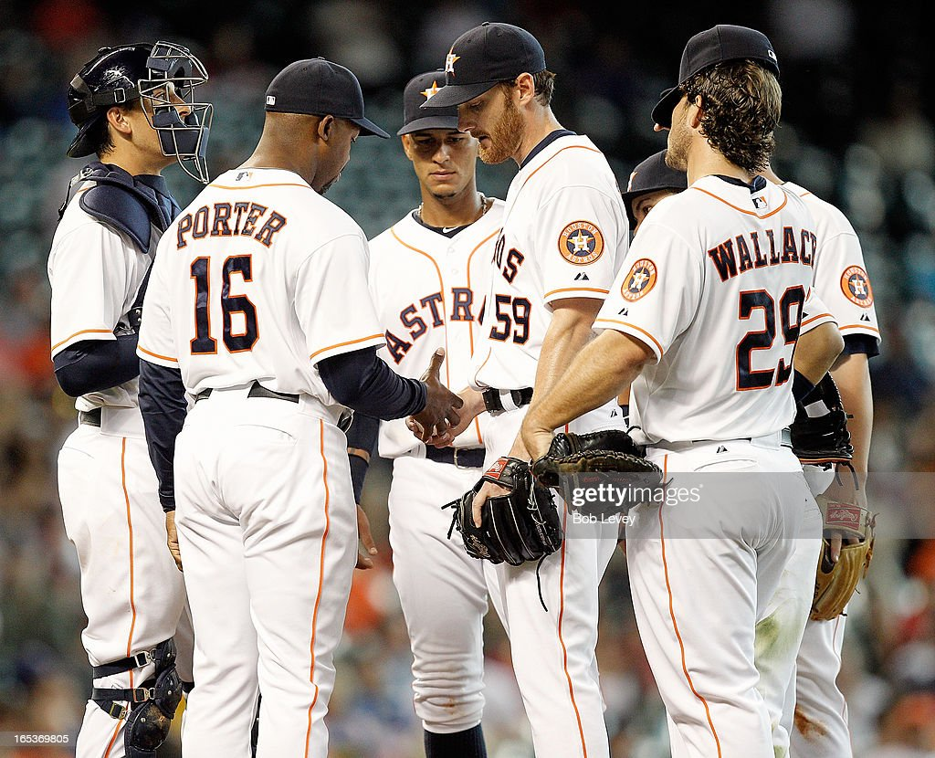 Bo Porter #16 of the Houston Astros takes <a gi-track='captionPersonalityLinkClicked' href=/galleries/search?phrase=Philip+Humber&family=editorial&specificpeople=836505 ng-click='$event.stopPropagation()'>Philip Humber</a> #59 of the Houston Astros out of the game in the sixth inning against the Texas Rangers at Minute Maid Park on April 3, 2013 in Houston, Texas.