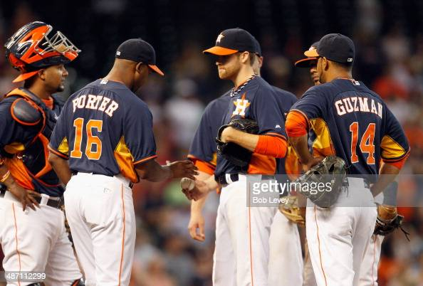 Bo Porter of the Houston Astros takes the ball from Collin McHugh in the ninth inning against the Oakland Athletics at Minute Maid Park on April 27...