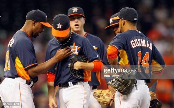 Bo Porter of the Houston Astros takes the ball from Collin McHugh of the Houston Astros at Minute Maid Park on April 27 2014 in Houston Texas