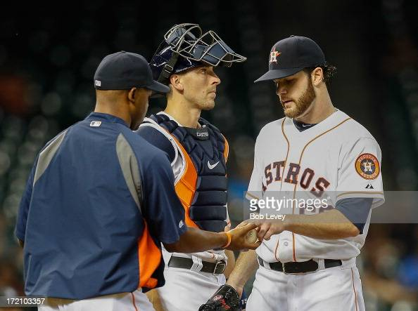 Bo Porter of the Houston Astros takes the ball from Dallas Keuchel of the Houston Astros as leaves the game in the fifth inning against the Tampa Bay...