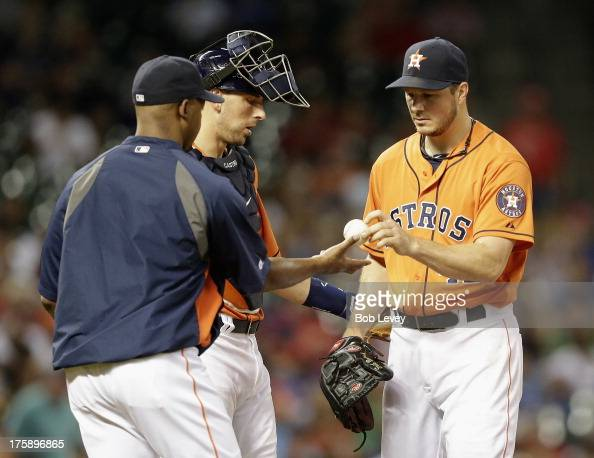 Bo Porter of the Houston Astros takes the ball from Erik Bedard of the Houston Astros as he leaves the game in the seventh inning against the Texas...
