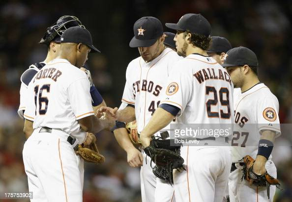 Bo Porter of the Houston Astros takes the ball from Jarred Cosart of the Houston Astros as leaves the game in the sixth inning at Minute Maid Park on...