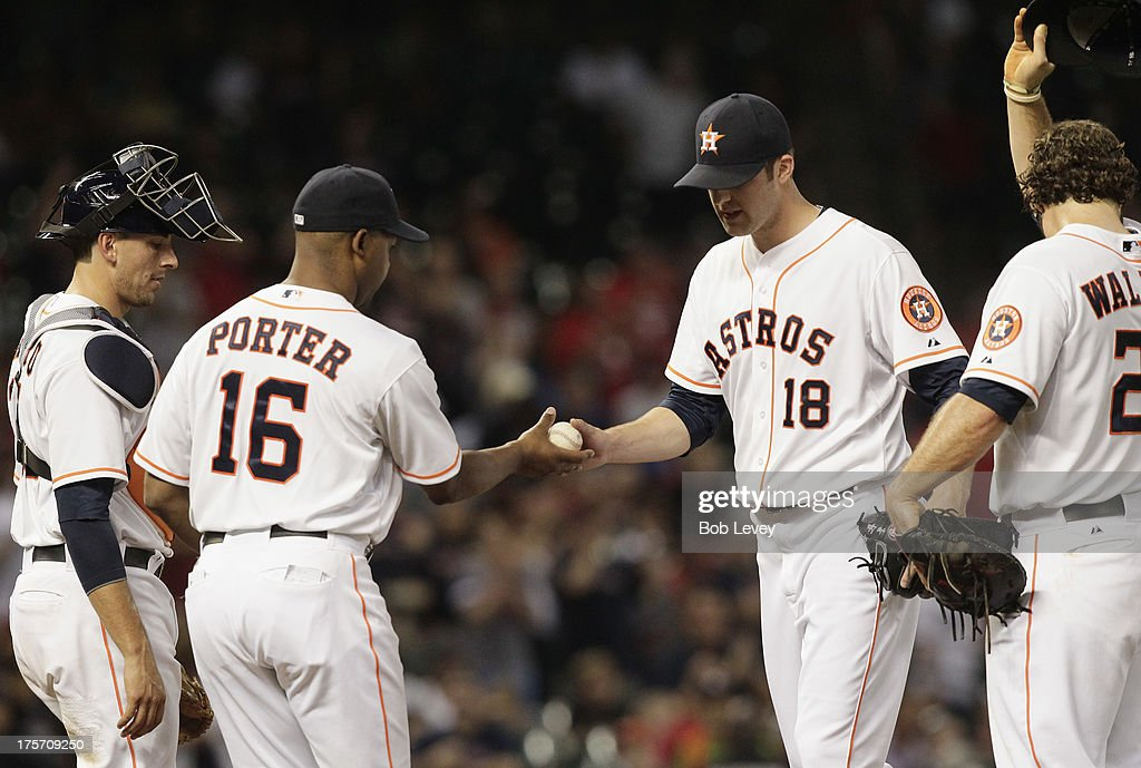 Bo Porter #16 of the Houston Astros takes the ball from <a gi-track='captionPersonalityLinkClicked' href=/galleries/search?phrase=Jordan+Lyles&family=editorial&specificpeople=7520081 ng-click='$event.stopPropagation()'>Jordan Lyles</a> #18 in the fifth inning against the Boston Red Sox at Minute Maid Park on August 6, 2013 in Houston, Texas.
