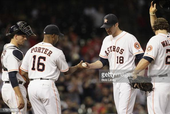 Bo Porter of the Houston Astros takes the ball from Jordan Lyles in the fifth inning against the Boston Red Sox at Minute Maid Park on August 6 2013...