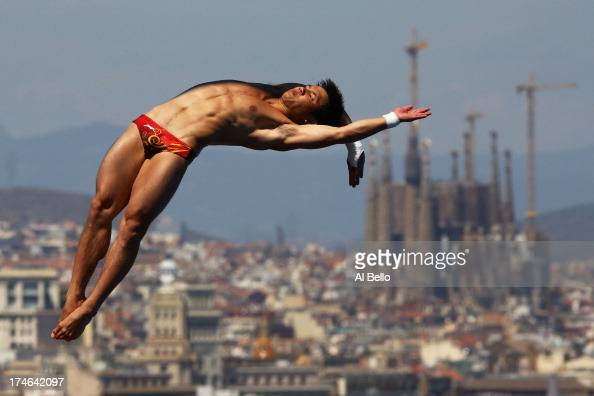 Bo Qui of China competes during the Men's 10m Platform Diving final on day nine of the 15th FINA World Championships at Piscina Municipal de Montjuic...