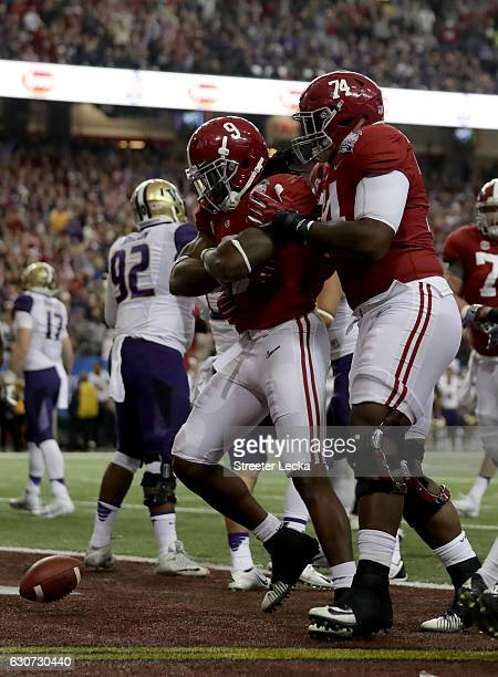 Bo Scarbrough and Cam Robinson of the Alabama Crimson Tide celebrate during the 2016 ChickfilA Peach Bowl at the Georgia Dome on December 31 2016 in...