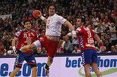 Bo Spellenberg of Denmark scores a goal against Nenad Vuckovic of Serbia and Rajko Prodanovic of Serbia during the Men's European Handball...