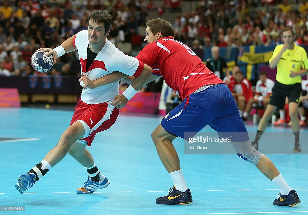 Bo Spellerberg #13 of Denmark is defended by <a gi-track='captionPersonalityLinkClicked' href=/galleries/search?phrase=Nikola+Manojlovic&family=editorial&specificpeople=3941098 ng-click='$event.stopPropagation()'>Nikola Manojlovic</a> #9 of Serbia in the Men's Preliminaries Group B match between Serbia and Denmark on Day 6 of the London 2012 Olympic Games at The Copper Box on August 2, 2012 in London, England.