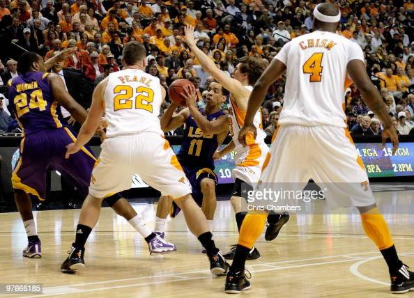 Bo Spencer of the LSU Tigers looks to pass the ball to Storm Warren as he is defended by the Tennessee Volunteers during the first round of the SEC...