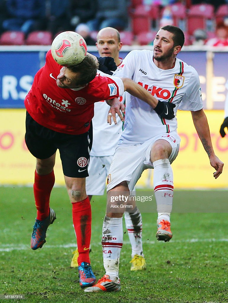 <a gi-track='captionPersonalityLinkClicked' href=/galleries/search?phrase=Bo+Svensson&family=editorial&specificpeople=635188 ng-click='$event.stopPropagation()'>Bo Svensson</a> (L) of Mainz is challenged by <a gi-track='captionPersonalityLinkClicked' href=/galleries/search?phrase=Sascha+Moelders&family=editorial&specificpeople=4296304 ng-click='$event.stopPropagation()'>Sascha Moelders</a> of Augsburg during the Bundesliga match between FC Augsburg and 1. FSV Mainz 05 at SGL Arena on February 10, 2013 in Augsburg, Germany.