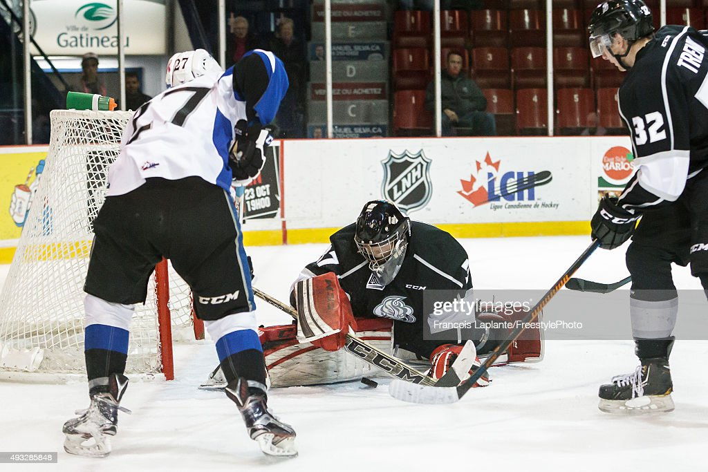 Bo Taylor #37 of the Gatineau Olympiques makes a save against Matt Green #27 of the Saint John Sea Dogs on October 18, 2015 at Robert Guertin Arena in Gatineau, Quebec, Canada.
