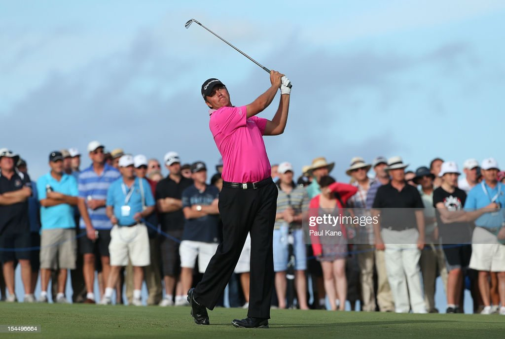 <a gi-track='captionPersonalityLinkClicked' href=/galleries/search?phrase=Bo+Van+Pelt&family=editorial&specificpeople=228036 ng-click='$event.stopPropagation()'>Bo Van Pelt</a> of the USA plays his approach shot on the 18th hole during round four of the Perth International at Lake Karrinyup Country Club on October 21, 2012 in Perth, Australia.