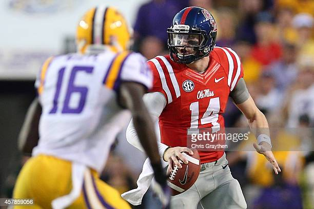 Bo Wallace of the Mississippi Rebels looks to throw a pass over Tre'Davious White of the LSU Tigers at Tiger Stadium on October 25 2014 in Baton...