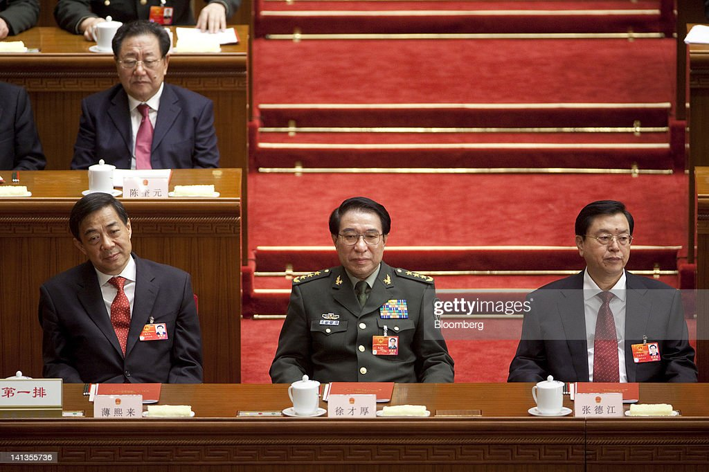 <a gi-track='captionPersonalityLinkClicked' href=/galleries/search?phrase=Bo+Xilai&family=editorial&specificpeople=225006 ng-click='$event.stopPropagation()'>Bo Xilai</a>, then Chinese Communist Party secretary of Chongqing, left, <a gi-track='captionPersonalityLinkClicked' href=/galleries/search?phrase=Xu+Caihou&family=editorial&specificpeople=4608621 ng-click='$event.stopPropagation()'>Xu Caihou</a>, vice chairman of China's Central Military Commission, center, and Zhang Dejiang, vice premier of China, attend the closing ceremony of China's National People's Congress (NPC) at the Great Hall of the People in Beijing, China, on Wednesday, March 14, 2012. China ousted Bo as Communist Party secretary of one the nation's biggest cities in the strongest rebuke of a Politburo member in at least five years as Premier Wen Jiabao seeks to end a political scandal before a leadership change due later this year. Photographer: Nelson Ching/Bloomberg via Getty Images