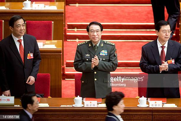Bo Xilai then Chinese Communist Party secretary of Chongqing left Xu Caihou vice chairman of China's Central Military Commission center and Zhang...