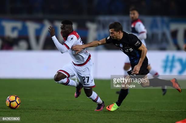 Boadu Acosty of Crotone is challenged by Remo Freuler of Atalanta during the Serie A match between Atalanta BC and FC Crotone at Stadio Atleti...