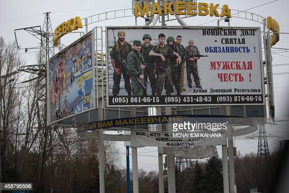 A board advertises to join the proRussian rebels on a main street near Donetsk on November 11 2014 The risk of violence in wartorn eastern Ukraine...