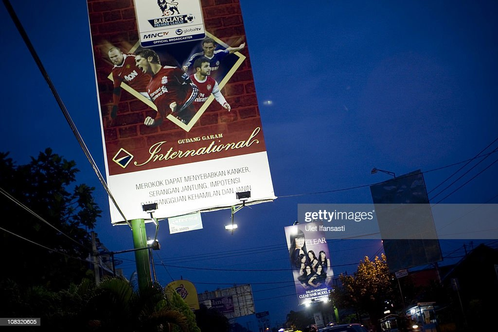 A board advertising a cigarette brand is seen on the roadside on January 25, 2011 in Yogyakarta, Indonesia. It is estimated that over 25 percent of children in Indonesia over the age of three have tried smoking, with over three percent of them smoking regularly. The lack of government regulation around advertising is blamed for the problem, with campaigns seen heavily at sporting events, music concerts. The Indonesian government previously passed a health bill in 2009 to address the issues, but it has not yet been implemented.