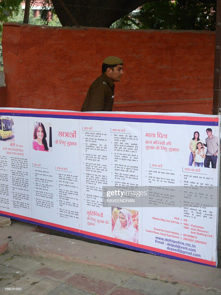 A board carrying a public service announcement from the Delhi Police - which advises female students to return home after class, avoid travelling with strangers, taking food and drink from unidentified people, and urging women to take up self-defence classes - is seen at the entrance gate of the Lady Sriram College in New Delhi on January 10, 2013. The public service announcement was placed outside the school following a gang rape which triggered mass protests across India over the levels of violence against women. A lawyer for the defendants in the New Delhi gang-rape case accused police on Thursday of beating confessions out of them as they appeared for their second court appearance. AFP PHOTO/RAVEENDRAN