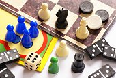 Board games, pawns, chessmen, dominoes and dice.