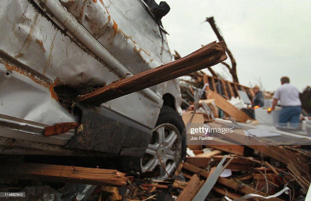 A board is seen stuck into the side of a vehicle after a massive tornado passed through the town killing at least 125 people May 27, 2011 in Joplin, Missouri. The town continues the process of recovering from the storm.