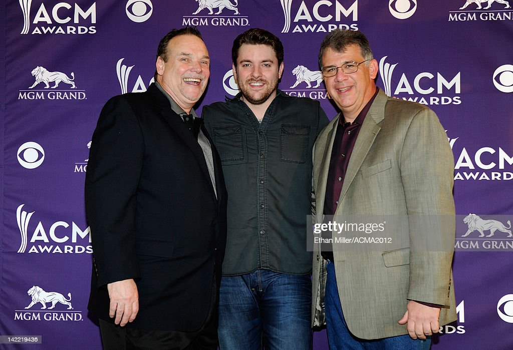 ACM Board member Bill Mayne, Singer Chris Young and CEO for the Academy of Country Music <a gi-track='captionPersonalityLinkClicked' href=/galleries/search?phrase=Bob+Romeo&family=editorial&specificpeople=619194 ng-click='$event.stopPropagation()'>Bob Romeo</a> pose onstage during ACM Radio Awards Reception at the MGM Grand Hotel/Casino on March 31, 2012 in Las Vegas, Nevada.