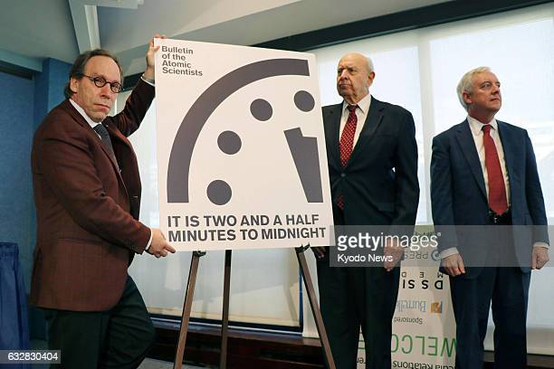 Board members of the magazine Bulletin of the Atomic Scientists present a panel in Washington on Jan 26 showing the minute hand on the symbolic...
