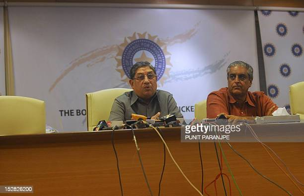 Board of Control for Cricket in India President N Srinivasan speaks as secretary Sanjay Jagdale watches during a news conference at their head office...