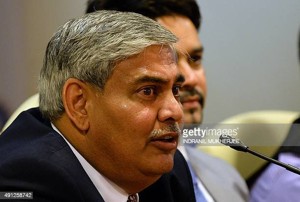 Board of Control for Cricket in India president Shashank Manohar answers questions as secretary Anurah Thakur looks on after taking charge at the...
